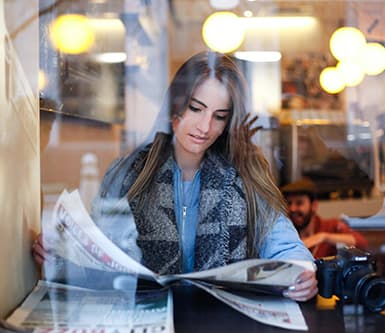 A girl reading newspaper