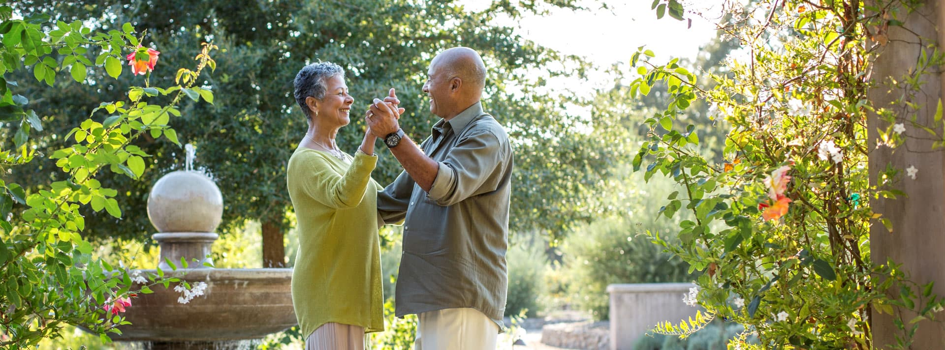 Senior couple dancing in a garden